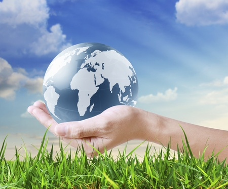 hands holding earth: holding a glowing earth globe in his hands