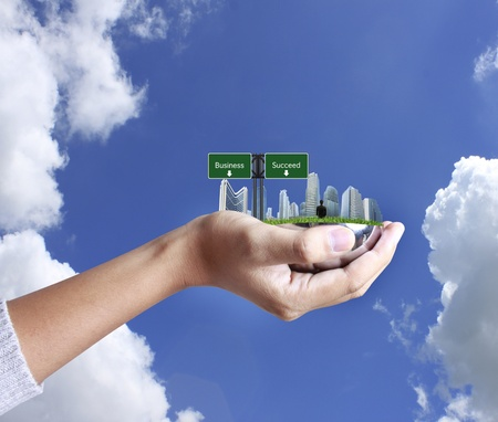 bright future: person holding a business, building on hand Stock Photo