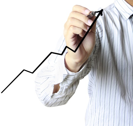 market trends: Male hand drawing a graph