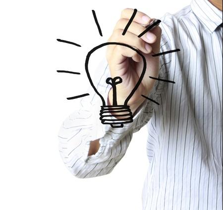 fresh idea: hand with a pen drawing light bulb