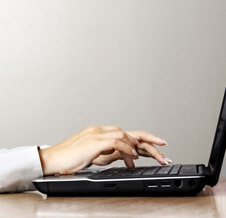 hands on the laptop keyboard  photo
