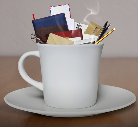 book and pen in a coffee cup photo