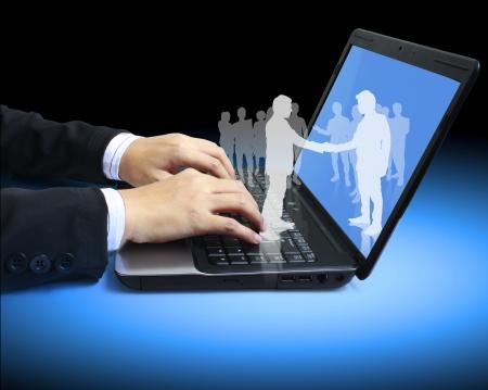 laptop keyboard: hands on the laptop keyboard