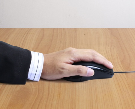 clicked: computer mouse with hand  Stock Photo