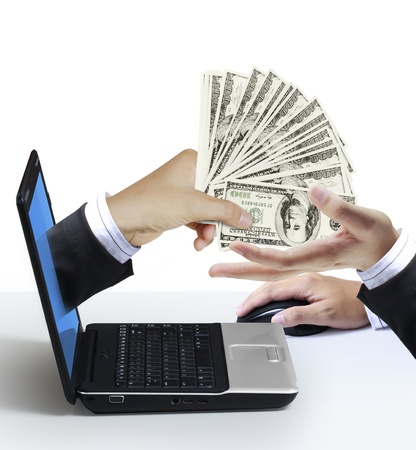 paying money: dollars appears from the laptop screen