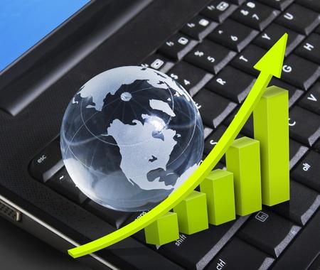 Graph globe on a laptop keyboard Stock Photo - 10224656