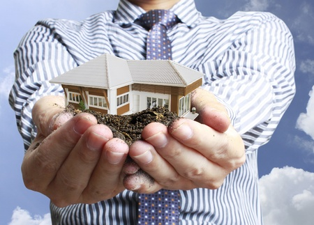 home finances: house in hands  Stock Photo