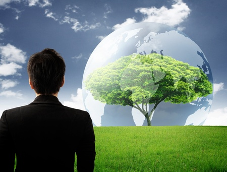 hands holding earth: Trees in the Globe Stock Photo