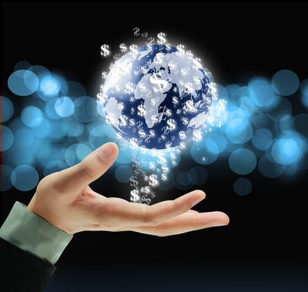business protection: earth globe in his hands