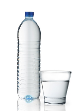 Bottle of water and glass isolated on white background