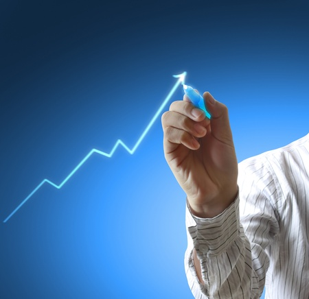 financial growth: Male hand drawing a graph
