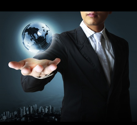 business protection: holding a glowing earth globe in his hands