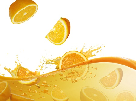 orange slices fall in juice on a white background  photo