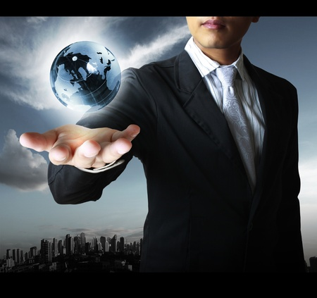 holding a glowing earth globe in his hands Stock Photo - 10850139
