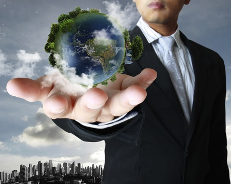 environmental protection: holding a glowing earth globe in his hands