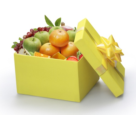 open yellow gift box, packing fruit  photo