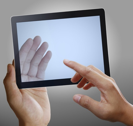 hand holding a touchpad  photo