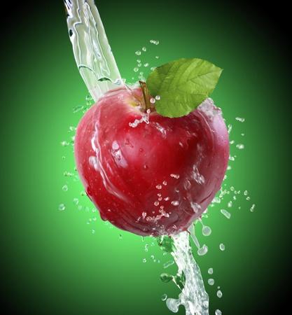 causing: Apple causing water splash  Stock Photo