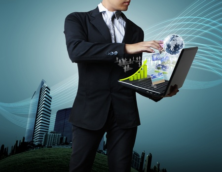 Businessman holding his laptop  photo