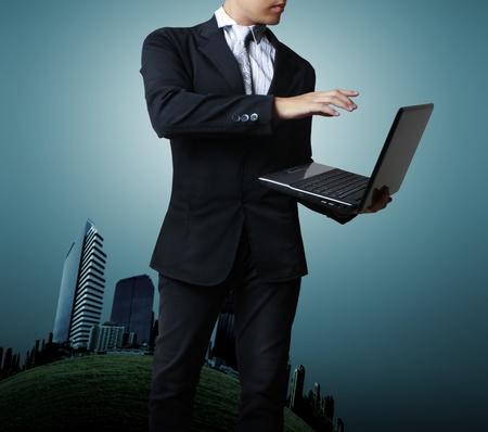financial world: Businessman holding his laptop Stock Photo