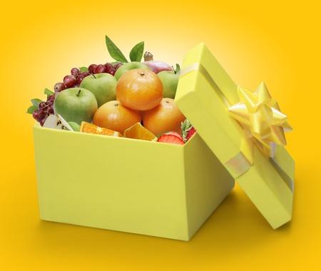 open yellow gift box, packing fruit  photo