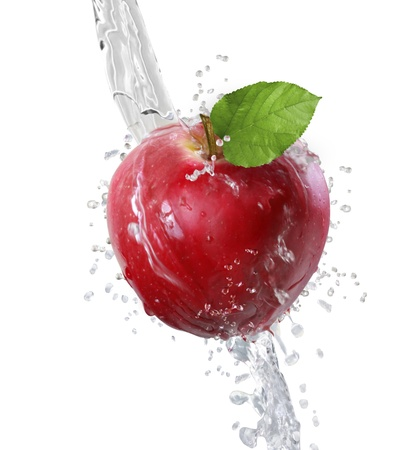 causing: Apple causing water splash  Stock Photo