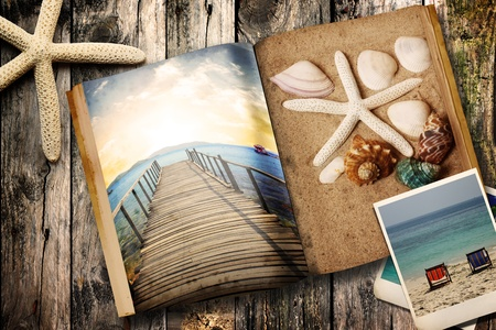Sea tematic book on wooden background Stock Photo - 11709654