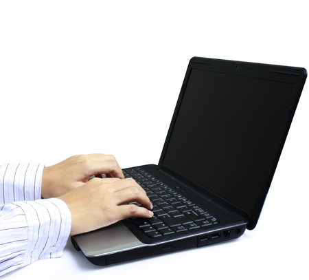 male hands typing on laptop keyboard  photo