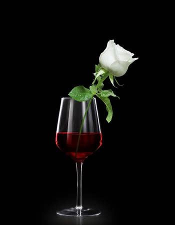 goblet: Glass of red wine and roses