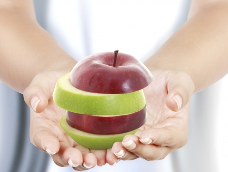 wellness background: Woman s hand holding apple
