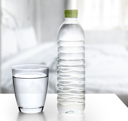 glass containers: Bottle of water with glass