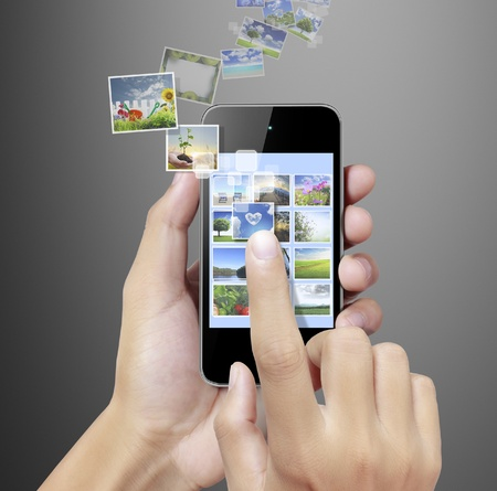 one smartphone with a gallery picture, gray background photo