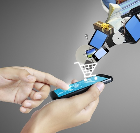 shoping with Touch screen mobile phone Stock Photo - 12527001