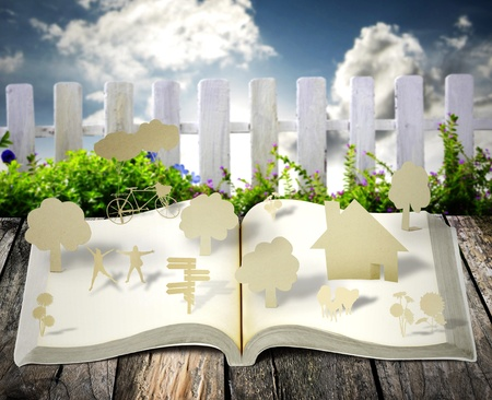 close up of open book with garden background photo