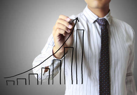 Male hand drawing a graph Stock Photo - 12811933