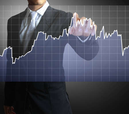 financial security: Hands with graphs  Stock Photo