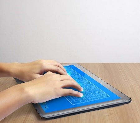 hands are pointing on touch screen tablet,touch-pad Stock Photo - 12811954