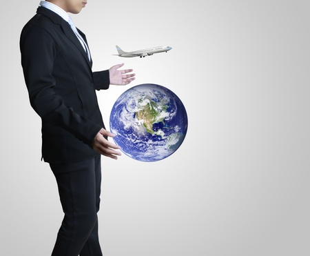 holding a glowing earth globe in his hands Stock Photo - 12961340