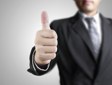 ring up: Business man hand with thumb up