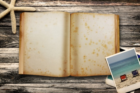 Sea tematic book on wooden background  photo