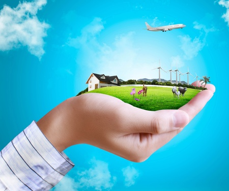 global village: human hand holding nature and to aviation