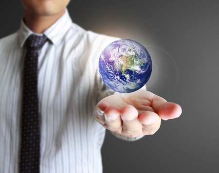 holding a glowing planet earth in his hands  Earth image provided by NASA  photo