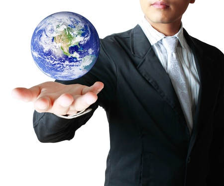 holding a glowing earth globe in his hands isolated on white background photo
