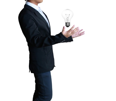 Light bulb in a hand  isolated on white background photo