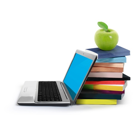 apple computers: Books and laptop isolated on white background