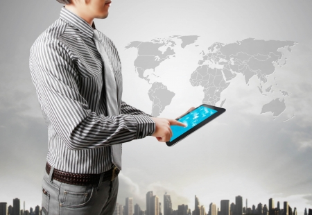 global economic crisis: touch tablet concept in hand