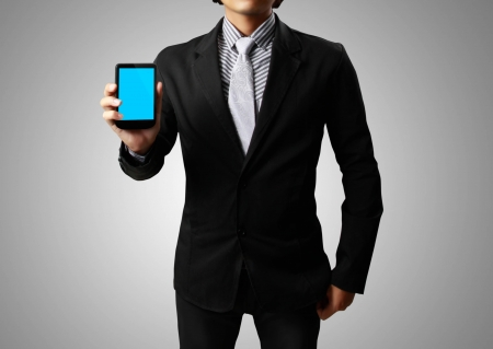 mobile phone in hand on gray background Stock Photo - 13662950