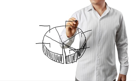 turnover: business man hand drawing a graph on white background Stock Photo