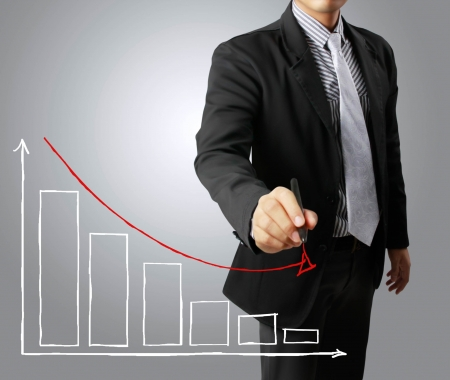 Business men hand drawing a graph Crisis photo