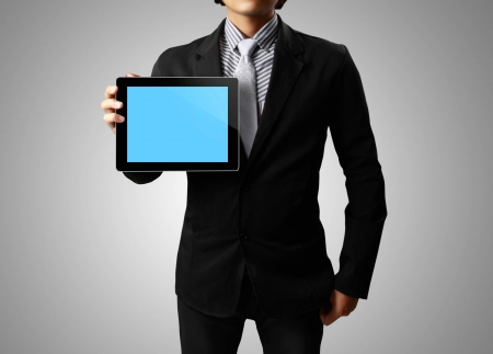 Businessman hands are holding the touch screen device,tablet photo